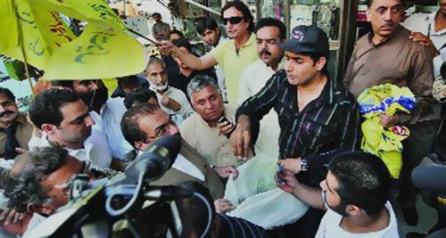 abrar-ul-haq collects funds for swat refugees