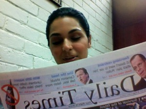 Meera Jee reading english newspaper