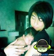 Meesha Shafi holding her baby