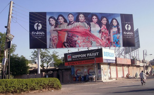 Billboard of Firdous Lawn featuring Bollywood Actress Kareena, showing Lawn Wars in Pakistan