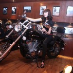 Girl on bike at Club Genova Karachi Launch Event