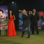 Zaheer Abbas taking shot, Veena Malik can be seen in the Background.