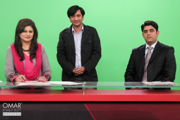 Shabnam Riaz and Basit Rehman pose with the Producer Hamid Sheikh on set.